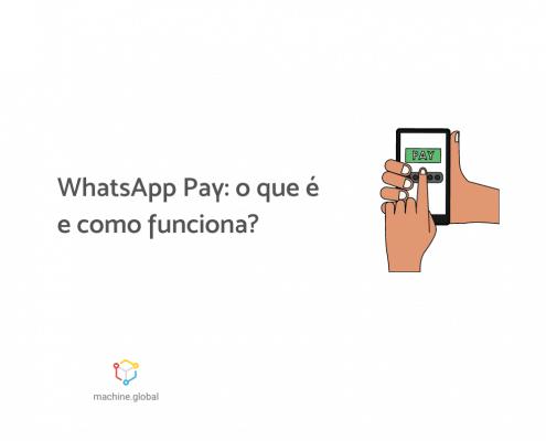"""Ilustração de uma mão segurando um whatsapp e pagando algo por ele. Ao lado está escrito """"WhatsApp Pay: o que é e como funciona?"""""""